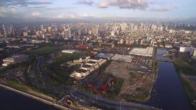 Cityscape av Manila, Filippinerna Nästan Bay City, Pasay med solnedgångljus arkivfilmer
