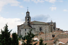 Cityscape of Avila with church on foreground. Avila, Spain - November 11, 2014:  Mosen Rubi chapel from The Medieval Walls of Avila. The old city and its Royalty Free Stock Photography