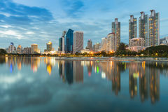 Cityscape at Bangkok Business District  twilight with water reflection Stock Photos