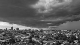 Cityscape of Bangkok city with rain cloud in black and white. Cityscape in black and white of Bangkok city with rain cloud in the sky, one side it& x27;s bright Royalty Free Stock Photography