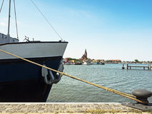 Cityscape of Barth at the bay on the Baltic Sea with ship in the foreground.  stock photos