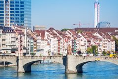 Cityscape of Basel with arched Middle bridge. Cityscape of Basel with stone arched Middle bridge across the Rhine river in the foreground Stock Image