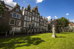 Cityscape in Begijnhof, Amsterdam. Begijnhof is one of the oldest inner courts in the city of Amsterdam Stock Photo