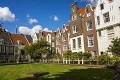 Cityscape in Begijnhof, Amsterdam. Begijnhof is one of the oldest inner courts in the city of Amsterdam Stock Photos