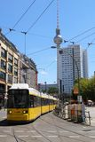 Cityscape of Berlin Hackescher Markt. TV tower in background.Cable car passing by and People walking around. stock image