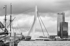 Cityscape, black-and-white - view of the moored sailboat on a background of skyscrapers district Feijenoord city of Rotterdam and. The Erasmus Bridge, The Royalty Free Stock Photo