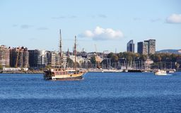 Cityscape with boats in bay. Royalty Free Stock Photo
