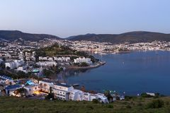 Cityscape of Bodrum, Turkey. Bodrum, Turkey - April 15, 2014: Blue hour cityscape with the St. Peter`s castle. Built in XV century, now the castle housed the Stock Images