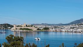 Cityscape of Bodrum, Turkey. Bodrum, Turkey - April 13, 2014: View to the St. Peter`s castle, harbor, and city. Built in XV century, now the castle housed the Royalty Free Stock Image