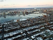 Cityscape of Boston and the Charles river in the evening in winter. Photo of the cityscape of Boston, MA, USA and the Charles river captured in the evening in Royalty Free Stock Images