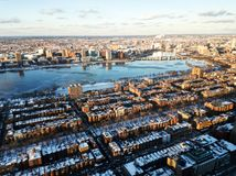 Cityscape of Boston and the Charles river in the evening in winter. Photo of the cityscape of Boston, MA, USA and the Charles river captured in the evening in Stock Photo