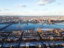 Cityscape of Boston and the Charles river in the evening in winter. Photo of the cityscape of Boston, MA, USA and the Charles river captured in the evening in Stock Photos