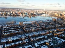Cityscape of Boston and the Charles river in the evening in winter. Photo of the cityscape of Boston, MA, USA and the Charles river captured in the evening in Stock Image