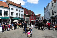Cityscape of Bruges, Belgium. Cityscape of Bruges with tourists, local cafes & bistro, and horse drawn carriage, Belgium Royalty Free Stock Images