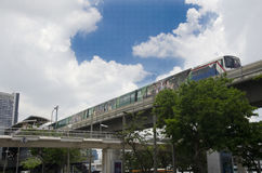 Cityscape and BTS or Skytrain running to stop at Mo Chit railway station Stock Photos