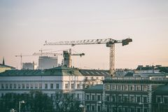Cityscape: buildings and cranes stock image