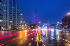 Cityscape of busy street with Tokyo tower Royalty Free Stock Image
