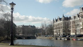 Cityscape and canal in Amsterdam. The Netherlands stock video footage