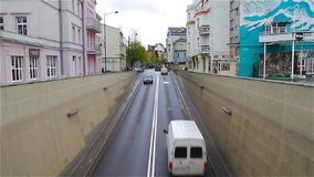 Cityscape. Cars enter the city tunnel, view from above.  stock footage