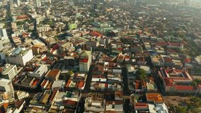 Modern city of Cebu with skyscrapers and buildings, Philippines. Cityscape: Cebu city with modern buildings, skyscrapers and business centers, top view during stock video footage