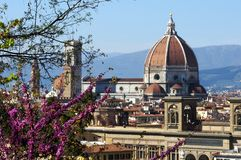 Cityscape with church Santa Maria del Fiore at spring day with flowers, Florence Royalty Free Stock Photos