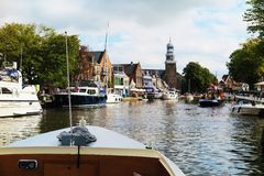 Cityscape, church and ships in Amsterdam Royalty Free Stock Image