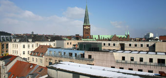 Cityscape church tower. Cityscape of aarhus in denmark with church spire and roof tops stock images