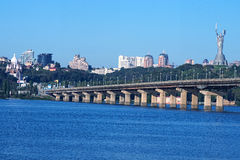 Cityscape. City on a sunny morning. Bridge connects the two parts of Kiev Royalty Free Stock Images