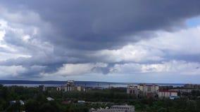 Cityscape and cloudscape tilt down stock video