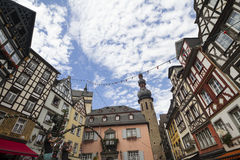 Cityscape of Cochem with its typical half-timbered houses and restaurants. Market square with town hall in background and music ba Royalty Free Stock Image