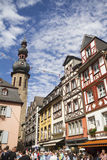 Cityscape of Cochem with its typical half-timbered houses and restaurants. Market square with town hall in background Royalty Free Stock Images