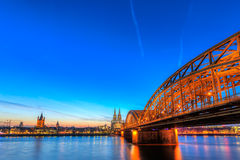Cityscape of Cologne from the Rhine river with blue sky Stock Photos