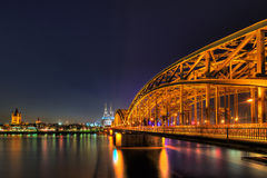 Cityscape of Cologne from the Rhine river at night Royalty Free Stock Photos
