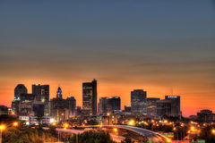 Cityscape of Columbus Ohio at dusk. Columbus Ohio skyline with dramatic sky and long exposure to capture car lights Royalty Free Stock Photo