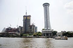 Cityscape and construction site with many boat in traffic water. At chao phraya river on February 16, 2017 in Bangkok, Thailand Royalty Free Stock Photography
