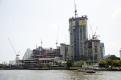 Cityscape and construction site with many boat in traffic water. At chao phraya river on February 16, 2017 in Bangkok, Thailand Royalty Free Stock Photos