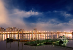 Cityscape of dock on the river in the night Royalty Free Stock Photography