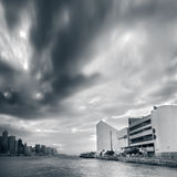 Cityscape of dramatic clouds motion near the bay royalty free stock photography