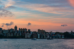 Cityscape with dramatic colorful evening sky on the background Stock Photography
