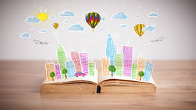 Cityscape drawing on open book Royalty Free Stock Photography