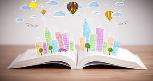 Cityscape drawing on open book. Colorful cityscape drawing on open book stock photos