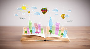 Cityscape drawing on open book Stock Image