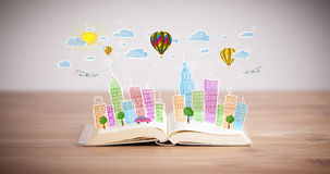 Cityscape drawing on open book Stock Images