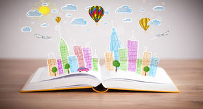 Cityscape drawing on open book. Colorful cityscape drawing on open book stock photo