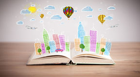 Cityscape drawing on open book Royalty Free Stock Images