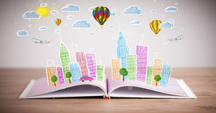 Cityscape drawing on open book Stock Photography