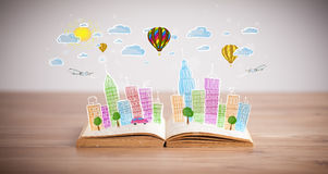 Cityscape drawing on open book Royalty Free Stock Photo