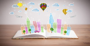 Cityscape drawing on open book Royalty Free Stock Image
