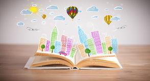 Cityscape drawing on open book stock photo