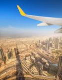Cityscape of Dubai from aeroplane window Royalty Free Stock Photo